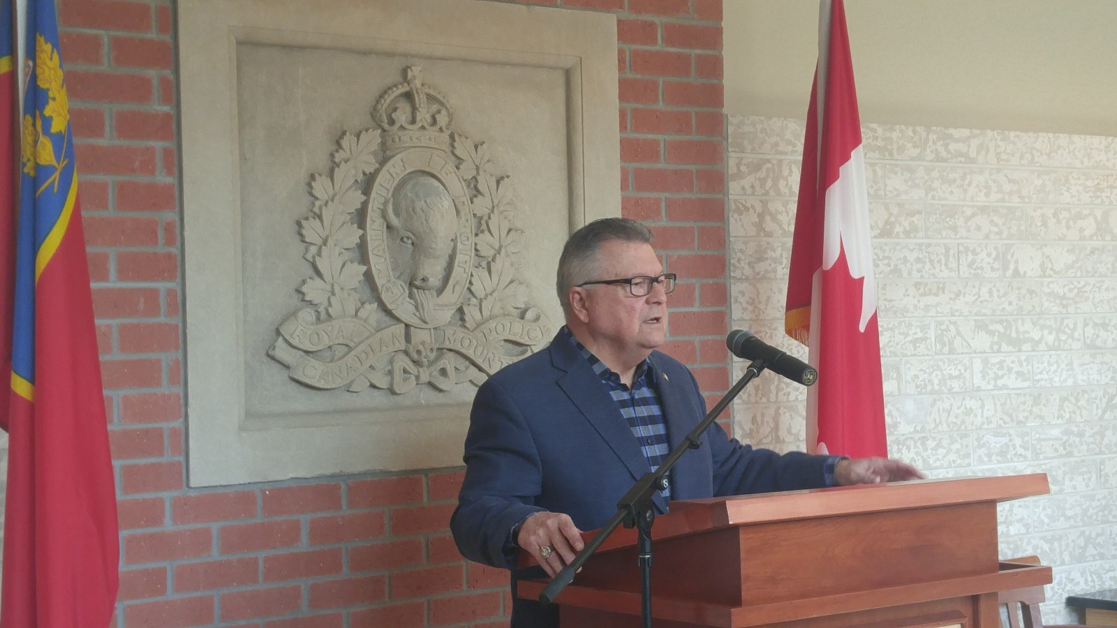 Federal Minister of Public Safety and Emergency Preparedness Ralph Goodale speaks in Regina about the Fort McMurray wild fires. Photo by Britton Gray