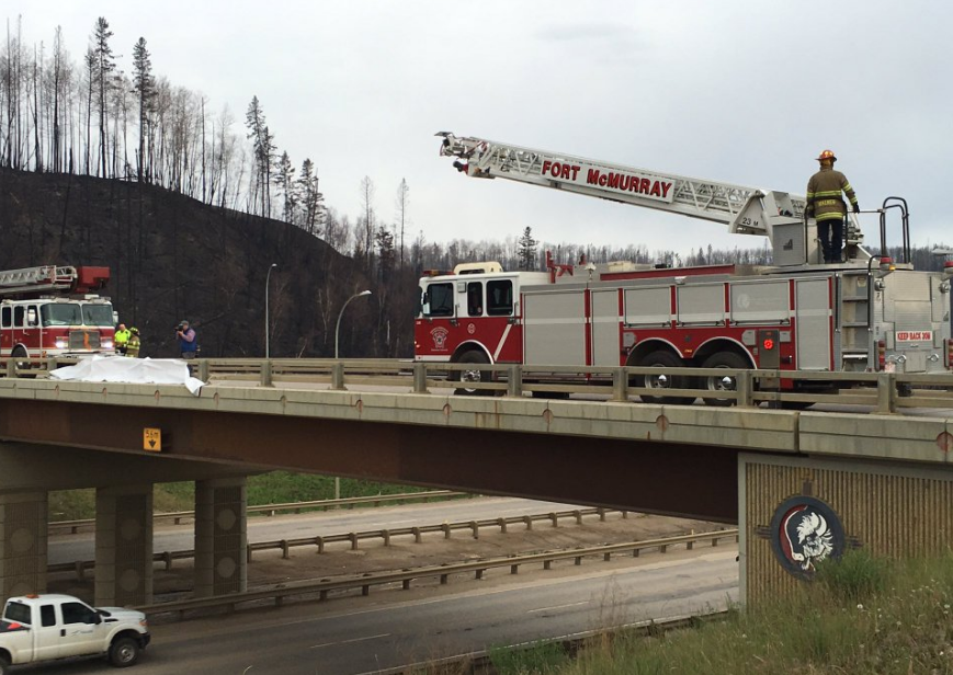 Fort McMurray Fire Fighters greet returning residents (photo: Crystal Laderas @CrisLaderas)