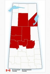 Red highlighted regions are under freezing rain/snow fall warnings. (Environment Canada)